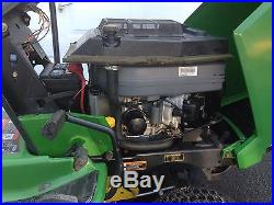John Deere LX188 lawn tractor/mower with snow blower and grass bagger